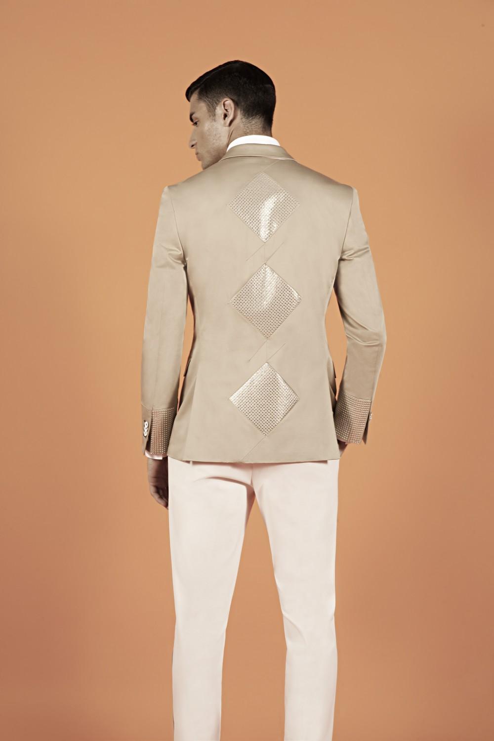 Colour: Khaki - Silver Fabric: Stretch cotton - Metal studs Lining : Viscose